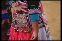 Hmong silver coins on New Year costume, Khek Noi, Thailand, 1986