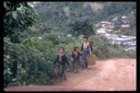 Hmong walking home from market, Thailand, 1986